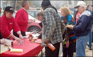 Kim Zavotski and Mike Janiszewski hand out food during Zavotski's Customer Appreciation Day