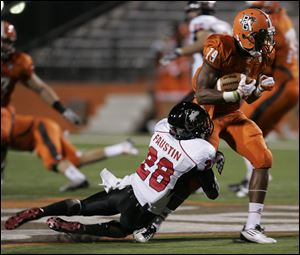 NIU's Jhony Faustin tackles BGSU's Kamar Jorden during game at Doyt L. Perry Stadium in Bowling Green.