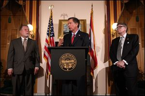 Ohio Senate president John Niehaus, left, Gov. John Kasich, center, and House Speaker William Batchelder talk in Columbus, Ohio, after the state's new collective bargaining law was defeated following an expensive union-backed campaign that pitted firefighters, police officers and teachers against the Republican establishment.