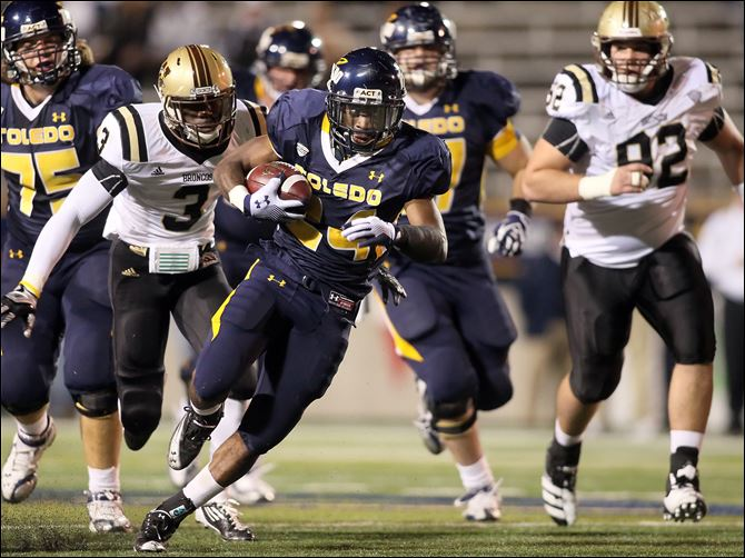 Adonis Thomas rushed for 216 yards against Broncos University of Toledo RB Adonis Thomas (24) runs the ball against  Western Michigan during the first quarter Tuesday, at the Glass Bowl in Toledo.