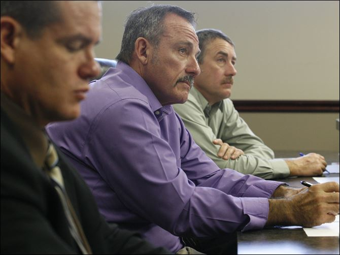 Bids to raze courthouse opened  Seneca County commissioners Ben Nutter, left, Dave Sauber, and Jeff Wagner are poised to award a demolition contract Nov. 17. B&B Wrecking of Cleveland submitted the low bid of $373,000.
