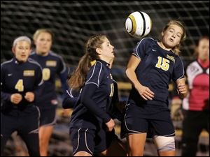 Archbold's Cassidy Wise (15) and Jesse Fidler (11) go after the ball against Shaker Heights Laurel.