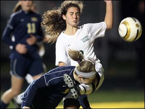 Archbold's Lauren Kindinger (14) gets kicked in the face by Shaker Heights Laurel's Abby Napoli (3).