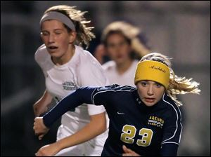 Archbold's Kassidy Garrow (23) goes after the ball against Shaker Heights Laurel.