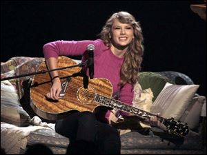"Taylor Swift performs ""Ours"" during the 45th Annual CMA Awards in Nashville, Tenn."