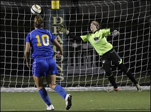 St. Ursula's Kiley Armstrong kicks the winning goal in a sudden-death shootout against Cuyahoga Falls Walsh Jesuit goalkeeper Caitlin Jakubek in Wednesday night's Division II state semifinal.