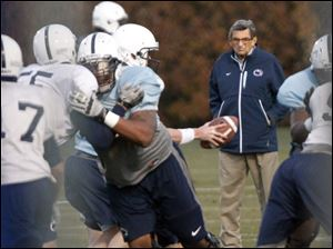 Coach Joe Paterno keeps an eye on a drill during practice Wednesday as the scandal of child abuse charges swirled around campus.