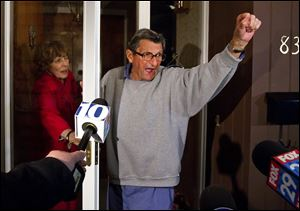 "Penn State coach Joe Paterno and wife Sue address students from the front porch of their home Wednesday night. The students yelled, ""We Are Penn State,"" and Paterno responded, ""Yes we are!"""
