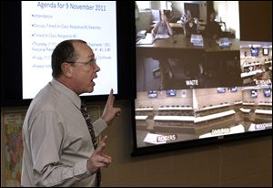 David Teall teaches an advanced placement class at Start High School that is transmitted to other schools in the Toledo Public Schools system. The distance-learning labs are in their first semester.
