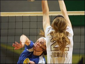 St. Ursula's Cassidy Croci, 6, fires the ball past Walsh Jesuit's Nicole Onderko, 22.