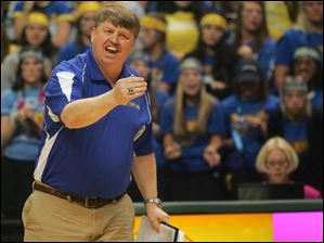 St. Ursula head coach John Buck shouts instructions during the game.