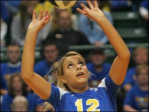 St. Ursula's Madison Strall sets the ball for her teammates.