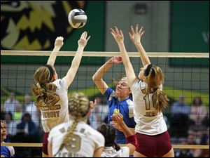 Walsh Jesuit's Nicole Onderko, 22, left and Emma Klein, 10, block the shot of St. Ursula's Cassidy Croci, 6.