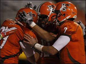 Falcon fullback Tyler Beck (89) is congratulated by teammates Alex Bayer (82) and Matt Schilz (7) after scoring the game's opening touchdown against Ohio.