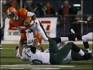 Ohio defensive end Tremayne Scott (90) trips up BG's Anthon Samuel (6).