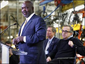 "Toledo Mayor Mike Bell, left, called Chrysler's investment ""the equivalent of a blood transfusion"" for Toledo as it struggles with high unemployment and significant poverty."