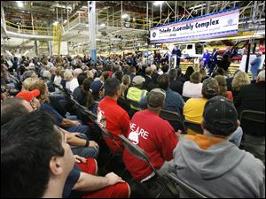 Hundreds of Chrysler workers listen to dignitaries speak about the automaker's $500 million investment in the Toledo plant.