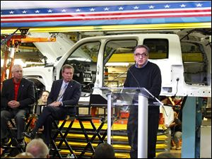 Chrysler CEO Sergio Marchionne, right, announces investment plans for the Toledo North plant as Ken Lortz, left, director of UAW Region 2B and Ohio Gov. John Kasich, center, listen.