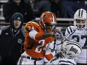 Bowling Green defender Jerry 'BooBoo' Gates (24) knocks down Ohio wide receiver LaVon Brazill (7) during the first quarter.