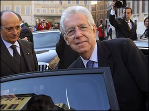 Economist Mario Monti gets in a car outside the Italian Parliament in Rome.