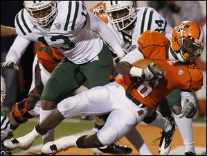 BG's Anthon Samuel (6) falls into safe territory during the game against Ohio University.
