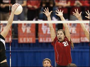 Temperance Bedford's Amanda Swisher leaps up to attempt a block on a Rockford spike.