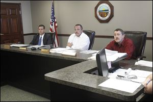 County Commissioners Ben Nutter, left, David Sauber, center, and Jeff Wagner, right, listen to citizens discuss the demolition bid for the Seneca County Courthouse.