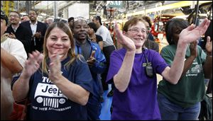 Among Jeep workers cheering at the announcement were Beverly Marsh, left, and Teresa Hoffman. The Chrysler CEO expressed his faith in the work force at the Toledo complex.