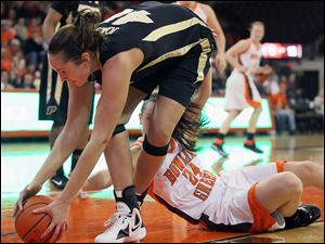 Purdue center Chelsea Jones (40) steals the ball from Bowling Green State University guard Logan Pastor (24).