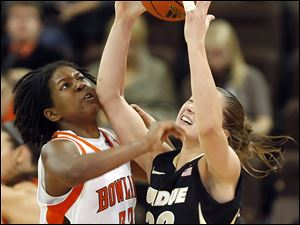 Bowling Green forward Alexis Rogers (32) knocks the ball away from Purdue forward Sam Ostarello (32).