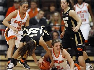 BG's Jessica Slagle battles Purdue's KK Houser for a loose ball Thursday as the Falcons nearly beat the 16th-ranked Boilermakers.
