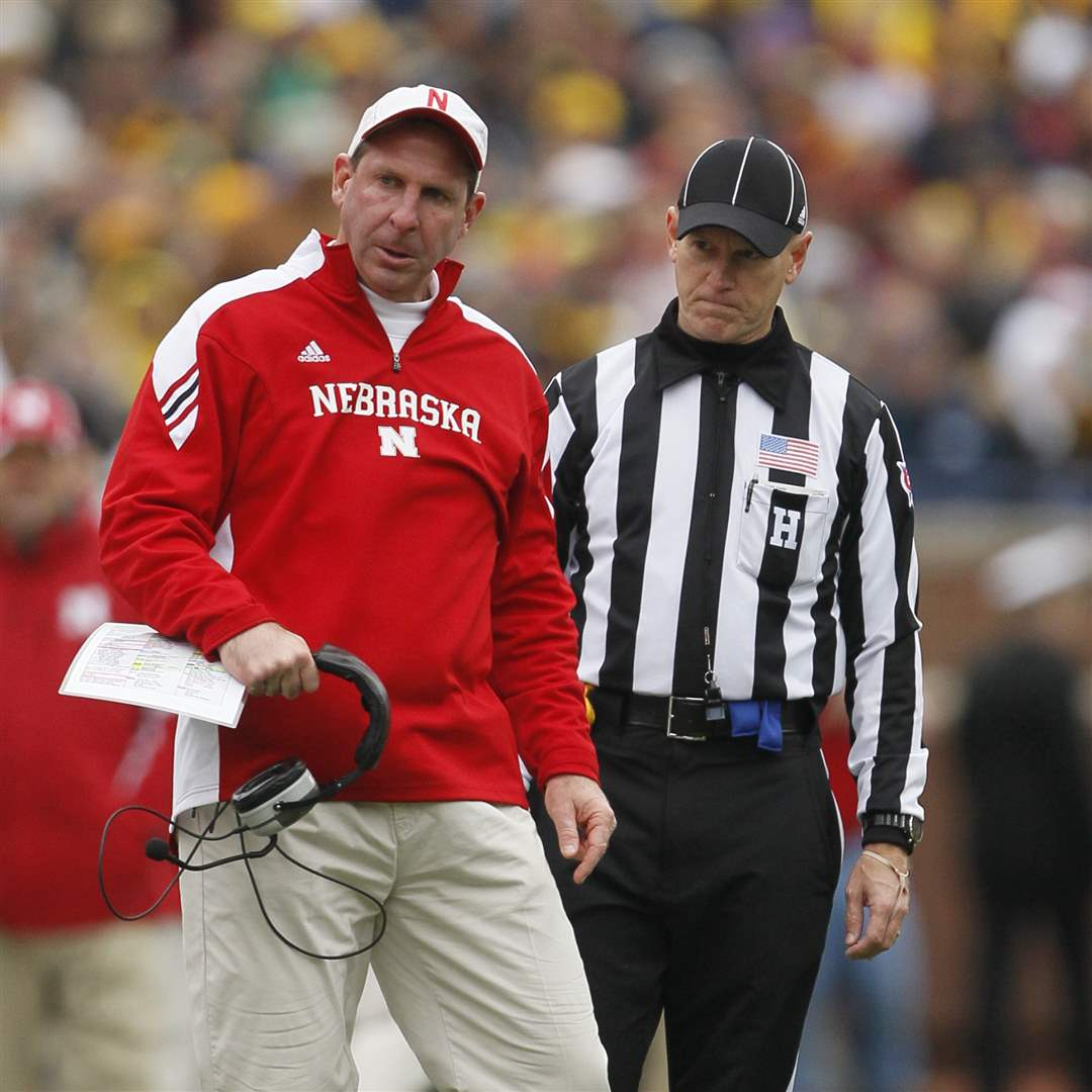 Nebraska-Cornhuskers-head-coach-Bo-Pelina-turns-away-from-a-referee