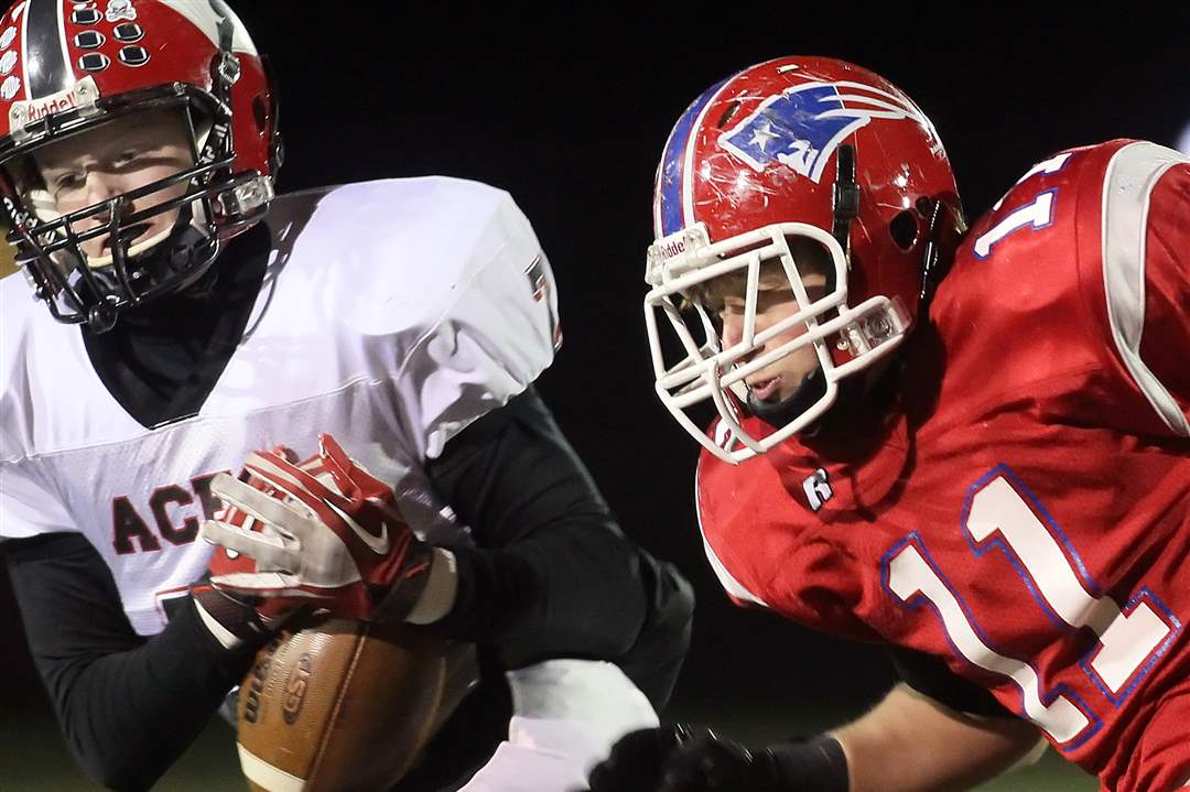 Hicksville-s-Yoder-intercepts-a-pass-intended-for-Patrick-Henry-s-Ziegler