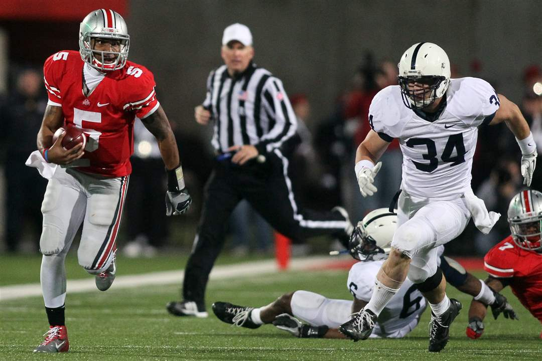OSU-quarterback-Braxton-Miller-scrambles-from-Penn-State-defenders