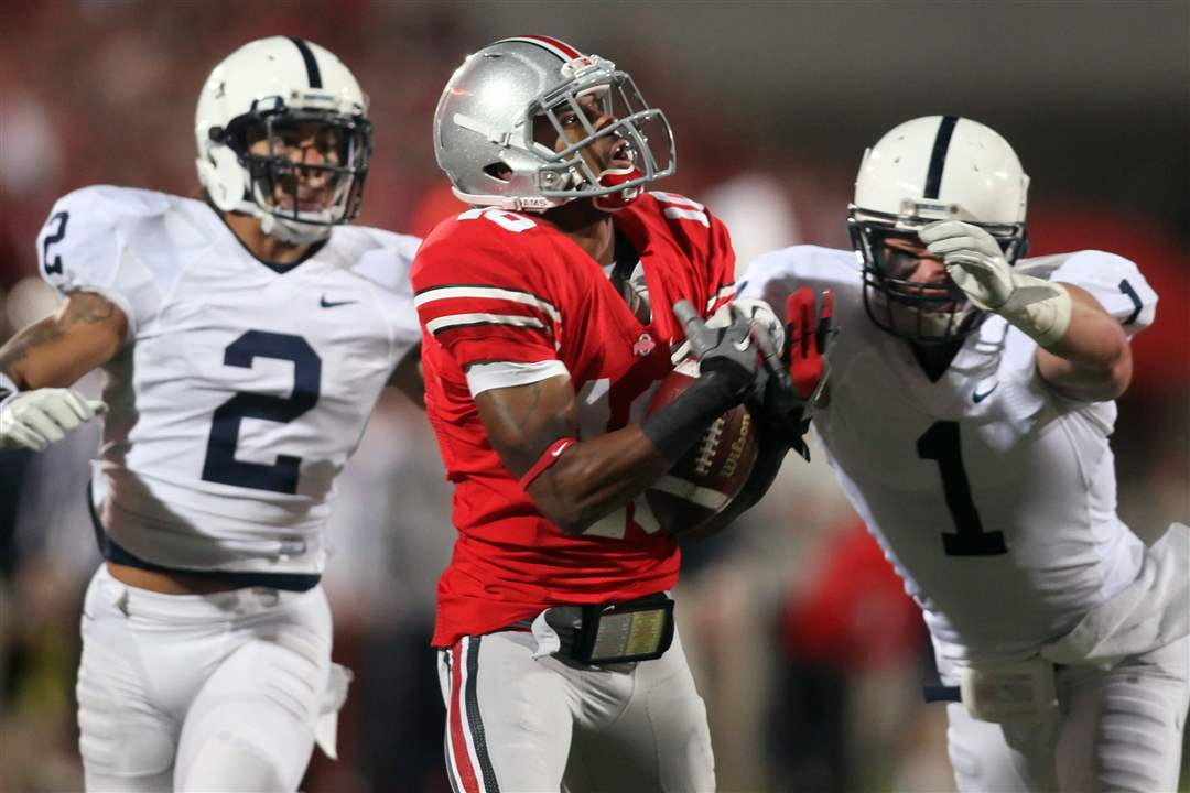 OSU-receiver-Corey-Brown-can-t-hold-onto-the-ball-with-Penn-State-defenders-in-pursuit