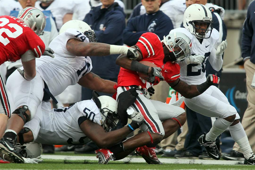 OSU-safety-Orhian-Johnson-is-broughd-down-by-Penn-State-after-an-interception