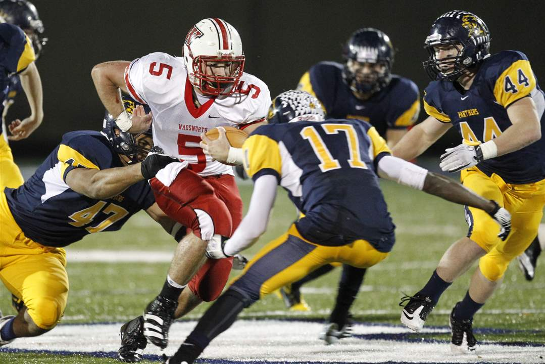 Wadsworth-s-Jack-Snowball-5-is-swarmed-by-Whitmer-s-defense