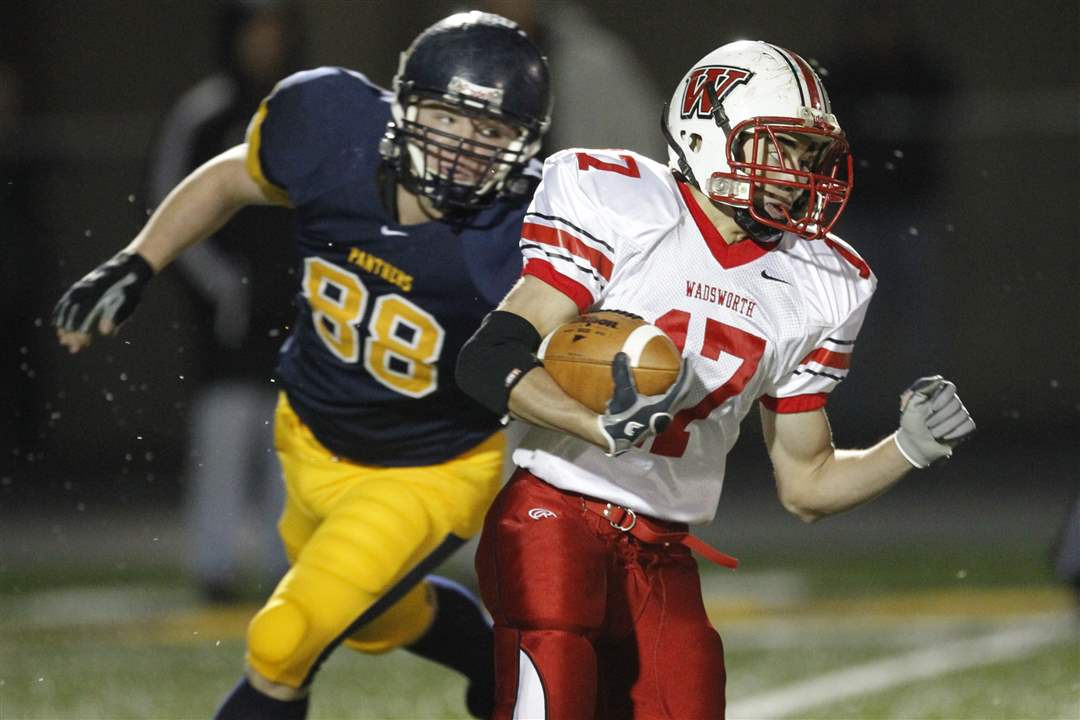 Wadsworth-s-Nate-Winkler-17-is-pursued-by-Whitmer-s-Nick-LaPoint