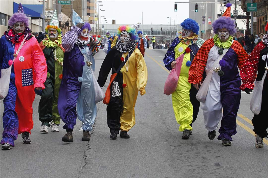 Clowns-from-the-Distinguished-Clown-Corps-march-down-Summit-St