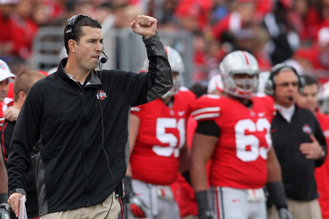 OSU-head-coach-Luke-Fickell-signals-to-his-team