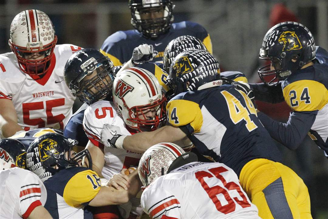 Wadsworth-s-Jack-Snowball-5-is-smothered-by-the-Whitmer-defense