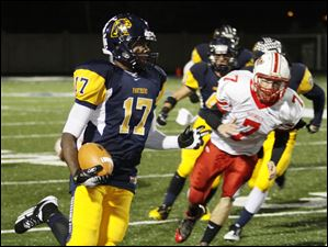 Whitmer's Mark Meyers, 17, returns an interception for a touchdown as Wadsworth quarterback Matt Alic, 7, pursues him during a Division I state playoff football game in Sandusky, Ohio, Saturday.