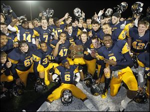 Whitmer players celebrate after defeating Wadsworth in a Division I regional championship playoff football game in Sandusky.
