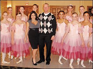 Nutcracker Sweets hosts Sonja and Jason Thompson, center, pose with dancers from the Ballet Theater Company of Toledo after they performed