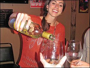 Christina Pelachyk pours wine at the Sweet Life benefit for Toledo Animal Shelter.