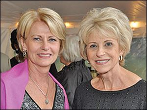 Committee members Candy Sturtz and Nancy Bell.