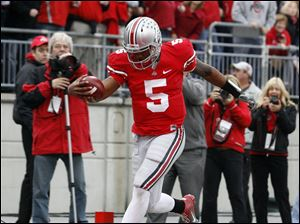 Ohio State quarterback Braxton Miller (5) scores a touchdown against Penn State during the second quarter Saturday.