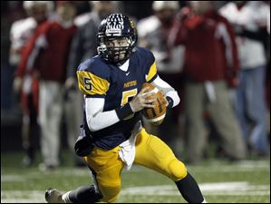 Whitmer quarterback Tyler Palka rolls out before throwing a touchdown pass to Alonzo Lucasce Larkin as the Panthers defeat Wadsworth in a Division I regional championship playoff football game in Sandusky.