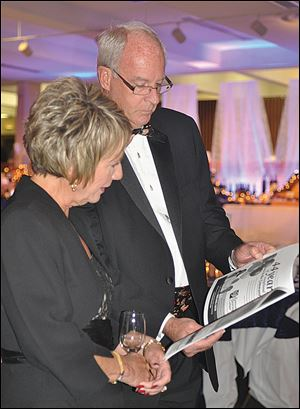 Jerry and Joyce Johnson look over the event program.