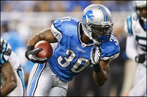 Detroit Lions running back Kevin Smith runs the ball for a touchdown in the fourth quarter of an NFL football game against the Carolina Panthers in Detroit, Sunday.